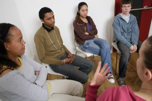 Young people in a meeting.