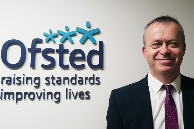 Picture of Matthew Brazier, Ofsted specialist advisor for looked after children, standing next to the Ofsted logo