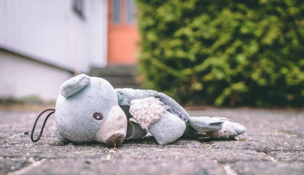 child's soft toy discarded on floor