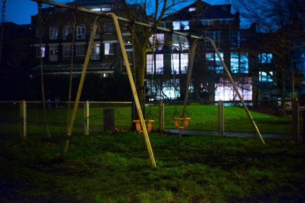 Picture of swings in a playground a night
